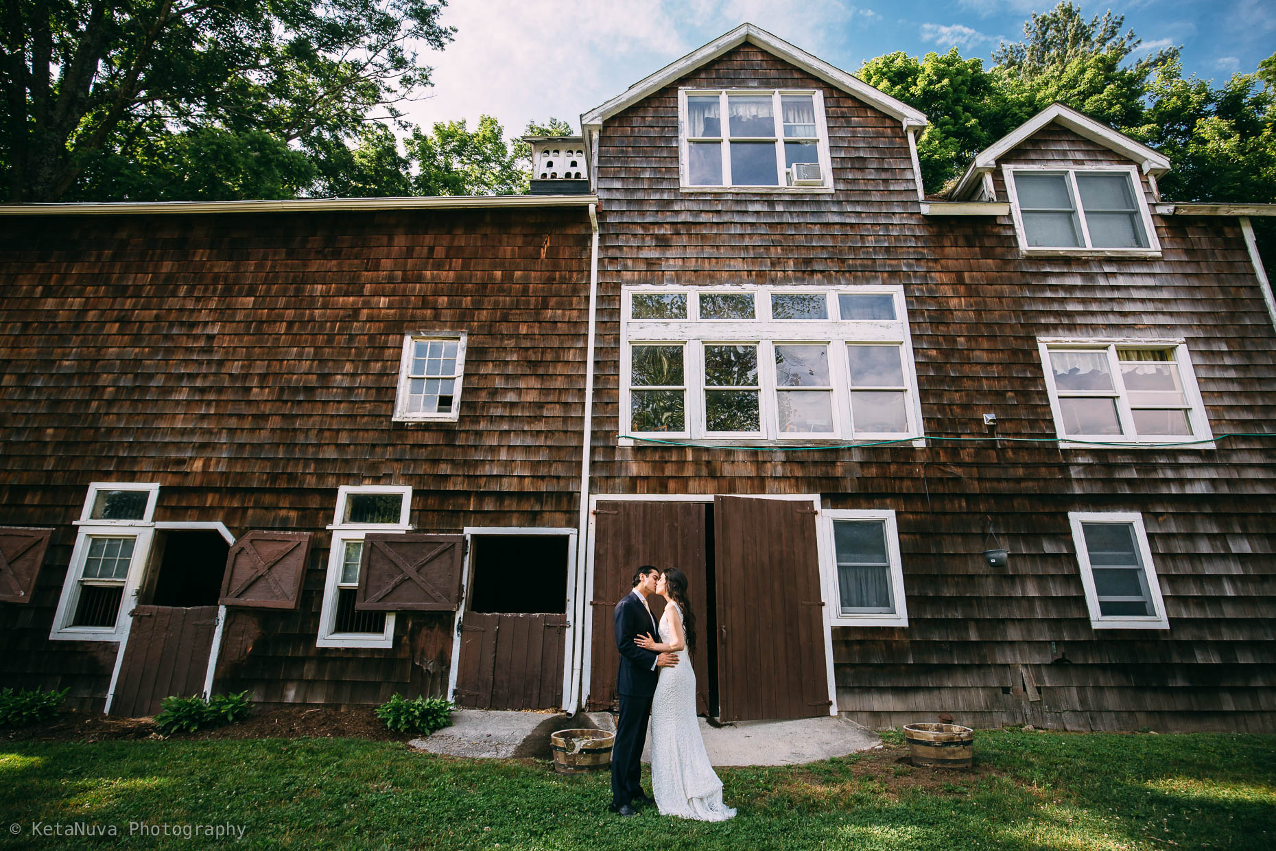 "Portrait of bride and groom in front of the farmhouse. "" width=""1860"" height="