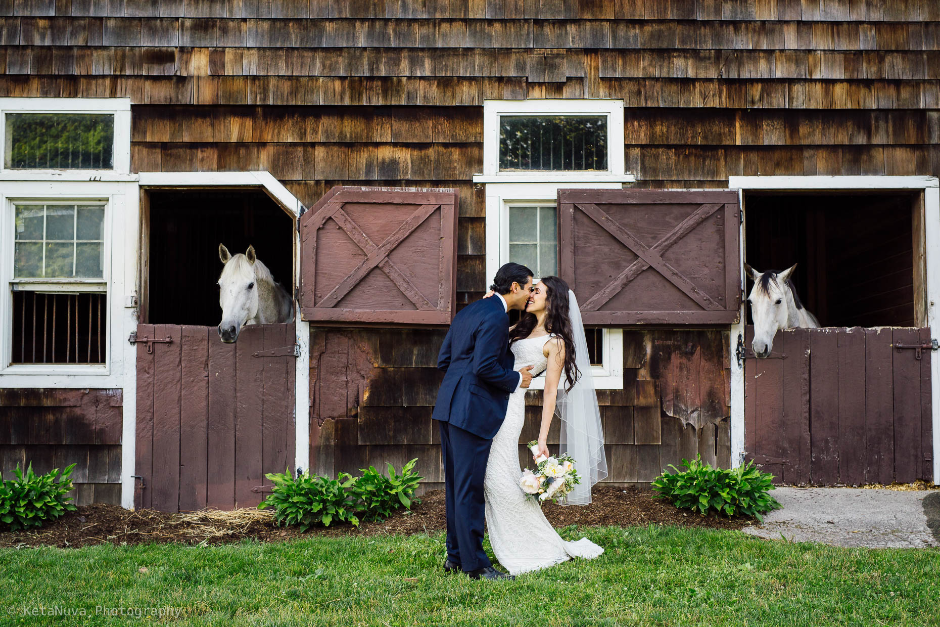"Hudson Valley rustic wedding - picture of bride and groom in front of the horse stable."" width=""1860"" height="