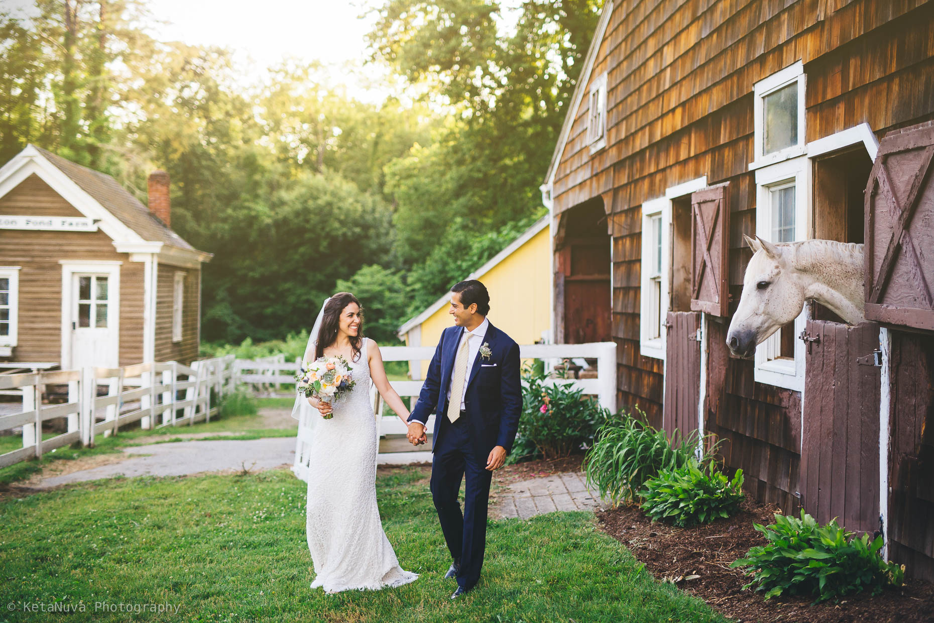 "Hudson Valley rustic wedding - beautiful portrait of the bride and groom taking a stroll in their farmhouse in Bedford Hills."" width=""1860"" height="